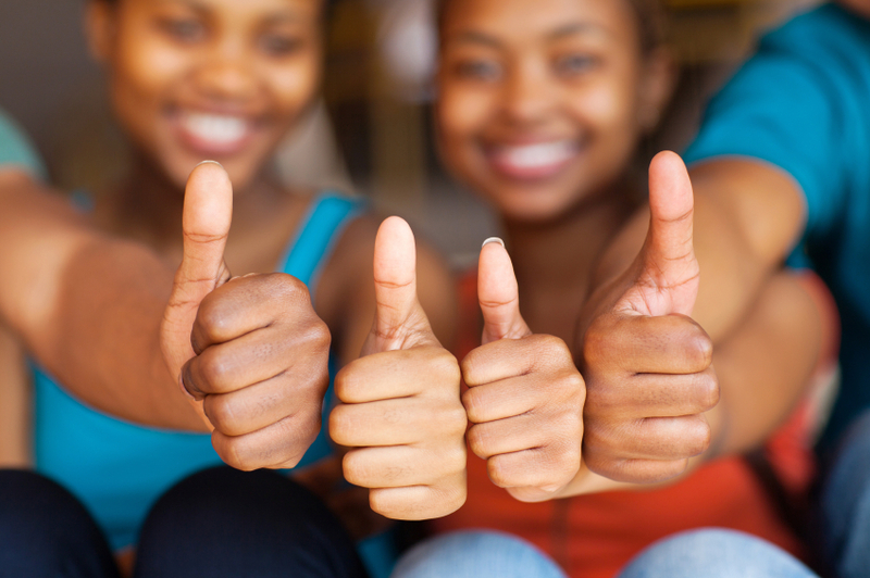 group of african friends thumbs up - Lead-It Africa